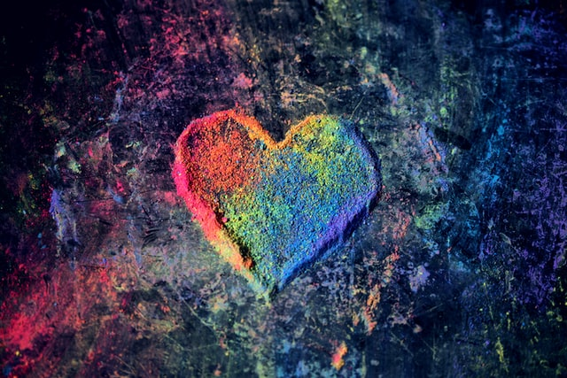 Image of a rainbow heart created with chalk. This image represents the healing from trauma that happens during trauma therapy in Baltimore, MD. Christina, a trained trauma therapist in Baltimore, MD can help you overcome trauma. | 21208